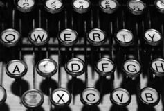 Antique typewriter qwerty keyboard. A black and white photo of a vintage antique typewriter keyboard stock photo