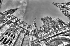 Black and white photo of the white marble statues of Cathedral Duomo di Milano on piazza Royalty Free Stock Image