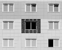 Black and white photo windows in a newly built house. wall structure with insulated non-combustible material basalt fiber tiled. Royalty Free Stock Photography