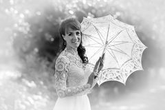 Black and white photo of a woman in a white dress Stock Photos