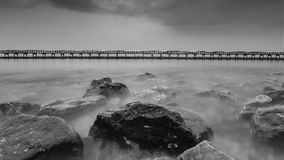 Black and white photo of the wooden bridge along the beach, Bangkok Thailand Stock Image