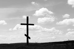 Black-and-white photo with wooden cross Royalty Free Stock Images