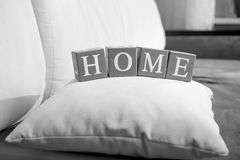 Black and white photo of word home spelled on wooden cubes stock images