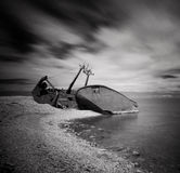 Black and white photo of wreck and rocky beach in Baltic Sea, natural environment. Stock Image