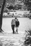 Black and white photo of young couple in love kissing on river Royalty Free Stock Image
