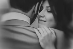 Black and white photo of young happy bride embraces groom soft focus Stock Photos