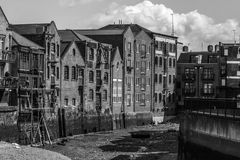 Black and white photograph of docklands buildings in London. On dry docks Stock Photo