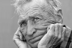 Black and white photograph of an elderly man. Black and white picture of a pensive elderly man Royalty Free Stock Image
