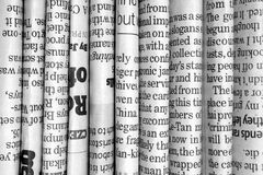 Row of Newspapers. A black and white photograph of English Language newspapers folded and stacked in a row to provide a background Stock Photography
