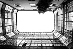 Black and white photographs of a rectangular courtyard up. Black and white photographs of a rectangular courtyard with glass balconies up Stock Photos