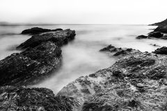 Black and white photographs of rocks with a movement wave like mist Royalty Free Stock Photo