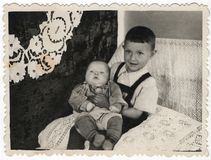 Black and white photographs of two young brothers. Stock Photography