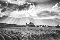 Black and white photography of Aigle Castle and Alps in Switzerland royalty free stock photos