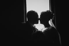 Black white  photography beautiful young couple stand on a dark background Stock Photo