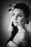 Black white photography beautiful young happy  bride standing near the window Royalty Free Stock Image