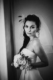 Black white photography beautiful young happy  bride standing near the window Stock Images