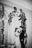 Black white photography  bride and groom posing in a hotel room Stock Photo