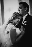 Black white photography bride and groom posing in a hotel room on background windows Royalty Free Stock Photography
