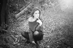 Black and white photography closeup of beautiful young lady sensually relaxing on outdoors royalty free stock photo