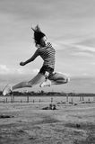 Black white photography of dance and jump, silhouette outdoors background Royalty Free Stock Image