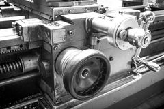 Black and white photography of flywheels slide lathe. On metalworking plant royalty free stock images