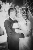 Black white  photography happy couple bride and groom embracing they stand on background Stock Photography
