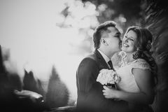 Black white  photography happy couple bride and groom embracing they stand on background Stock Photo