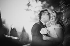 Black white  photography happy couple bride and groom embracing they stand on background Stock Photos