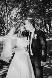 Black white photography happy couple bride and groom embracing they stand in a forest Stock Images