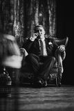 Black white  photography portrait of man in black classic suit on a dark background. Stock Image
