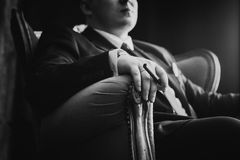 Black white  photography portrait of man in black classic suit on a dark background. Stock Images