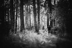 Black white photography romantic young couple go and holding hands on background summer Royalty Free Stock Image