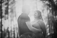 Black white photography romantic young couple kissing on background summer forest. Black white photography romantic young couple kissing  on background summer Royalty Free Stock Image