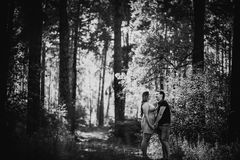 Black white photography  romantic young couple kissing on background summer forest. Black white photography romantic young couple kissing  on background summer Stock Photography