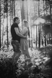 Black white photography romantic young couple laugh on background summer forest Stock Images