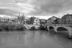 Black and White photography Rome: bridge on the Tiber River church  city skyline Stock Photo