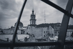 Black and white photography. View of the church hall from the roof. Of an old house in cloudy weather. Lviv, Ukraine stock photos