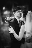 Black white photography wedding beautiful young couple stand on background forest Stock Image