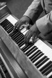 Black and white piano. Hands playing an old piano Royalty Free Stock Images