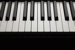 Black and white piano keys. On dark background royalty free stock photo