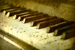Black and white piano keys. Music notes background royalty free stock image