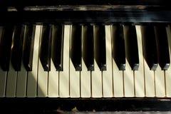 Black And White Piano Keys Close-up. Old piano. Music Education. Black And White Piano Keys Close-up. Old piano. Cropped Shot Of An Old Piano stock images