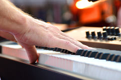Black and white piano keys with hand. Black and white piano keys and hand fingers pressing the keys Royalty Free Stock Photography