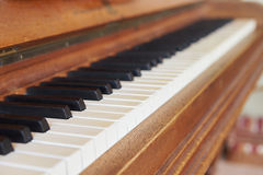 Black and white piano keys on historical piano with ivory keys Royalty Free Stock Photography
