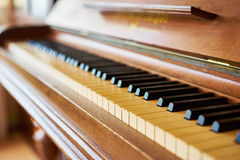 Black and white piano keys on historical piano with ivory keys Royalty Free Stock Image