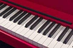 Black and white piano keys red. Close-up Stock Images