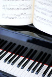 Black and white piano keys and sheet music stock photography