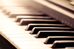 Black and white piano keys in vintage color tone Stock Images