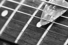 Black and white pick and vintage electric guitar Royalty Free Stock Images