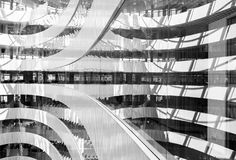Black and white picture of abstract looking interior of modern business center. Black and white picture of abstract interior of modern business center, geometric stock photo